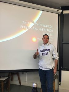 Person standing with Thumbs Up in front of Lecture Screen