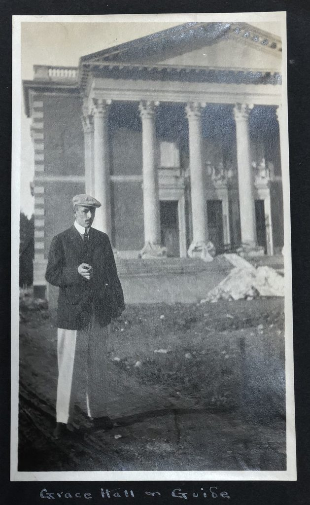 A black and white photograph of E. K. Gillett in front of Grace Hall construction (now Chapin Hall).