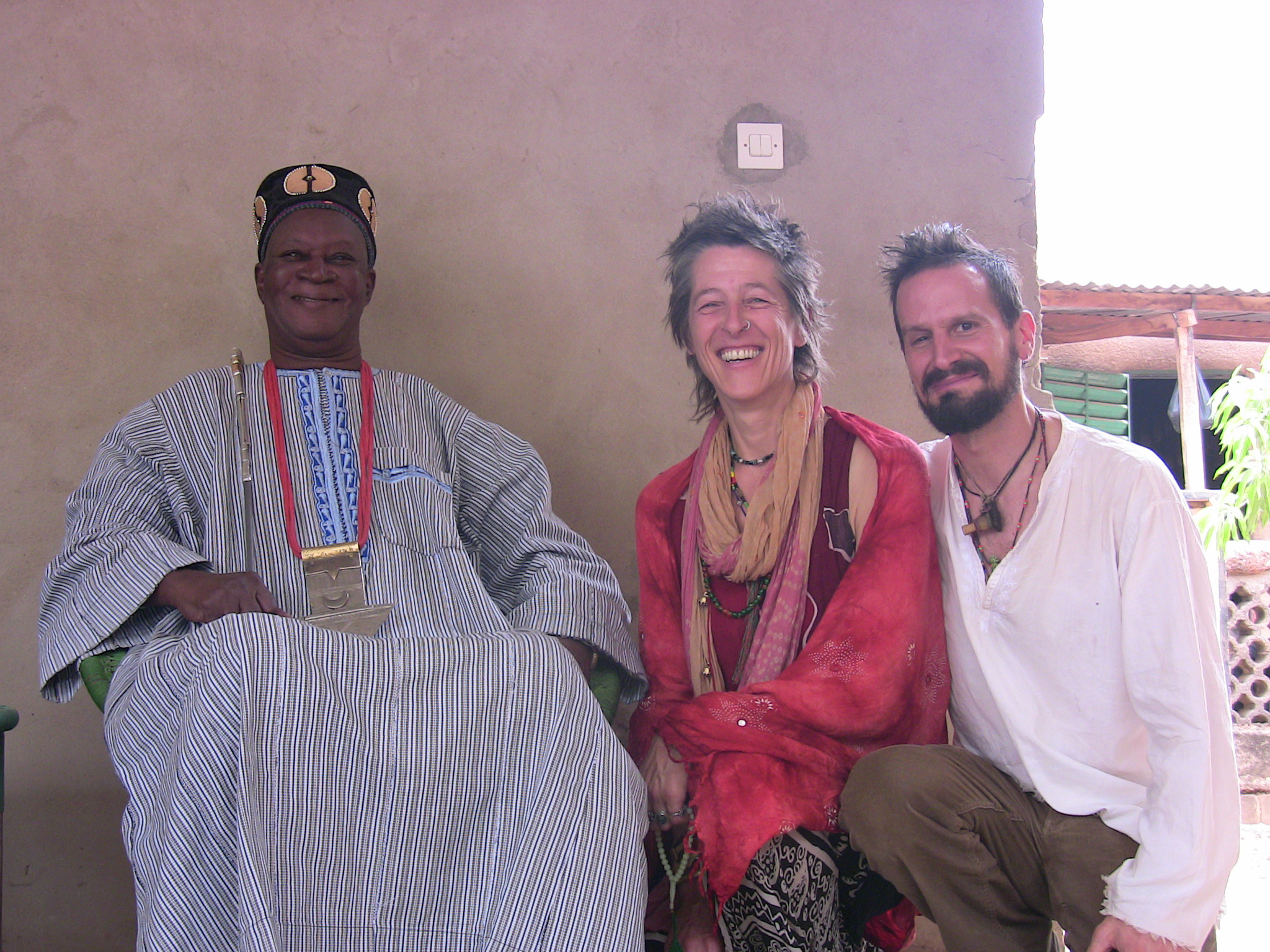 Three people posing for a photograph