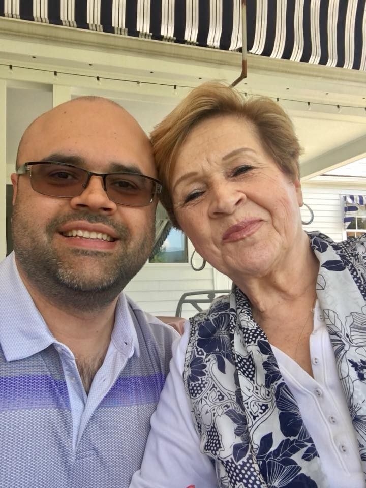 a photo of Juan with his mother, Maria.