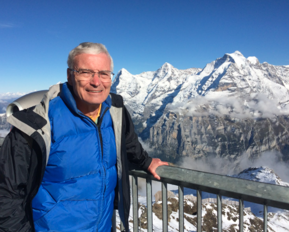 Bill Wadt at the Schilthorn looking towards the Eiger, Monch, and Jungfrau in Switzerland