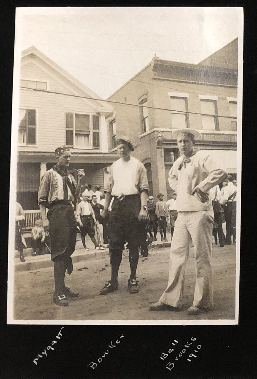 A black and white photo of three men dressed as pirates and a sailor at their Williams class reunion in 1913.