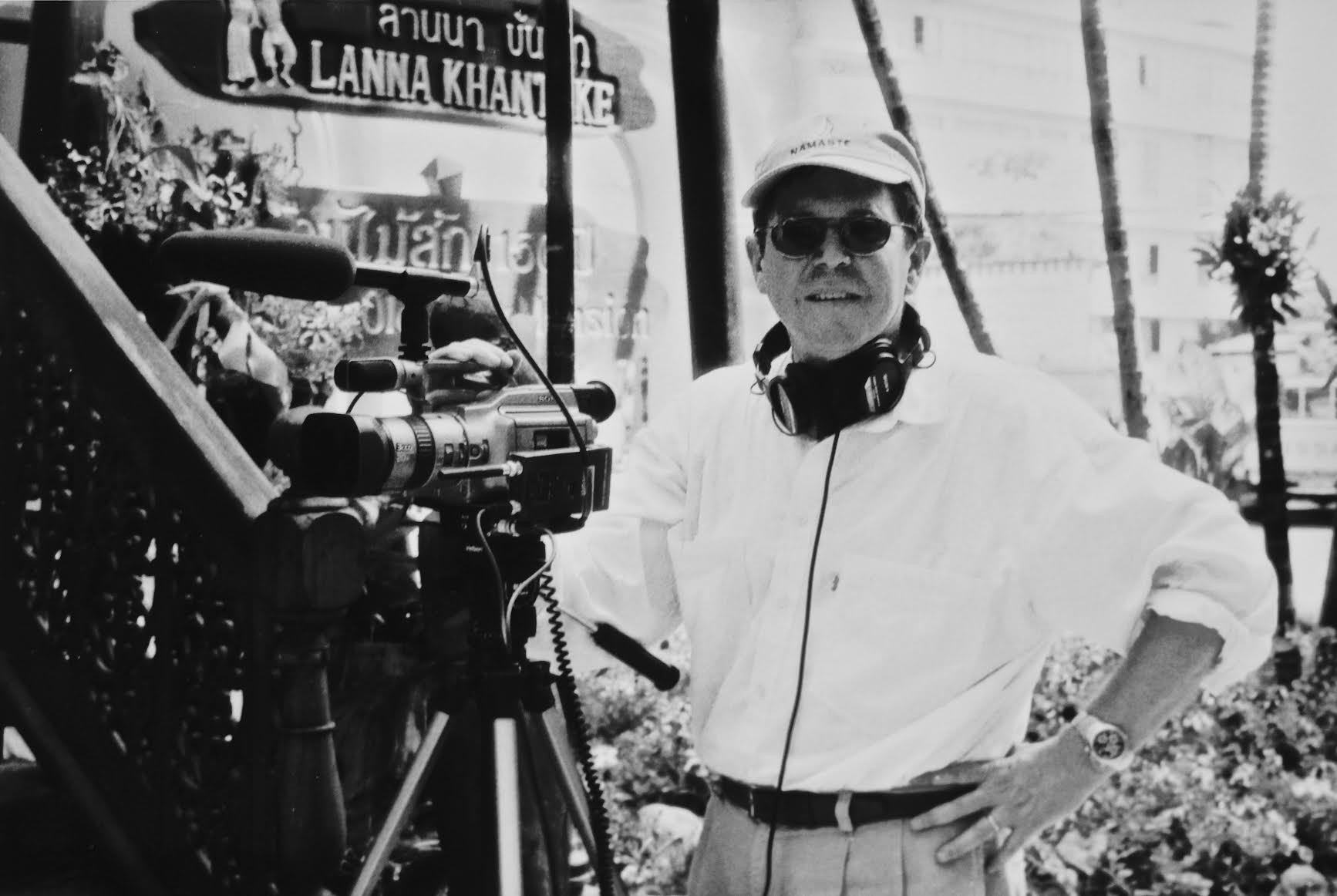Black and white photo of Michael Rosenblum in front of video camera