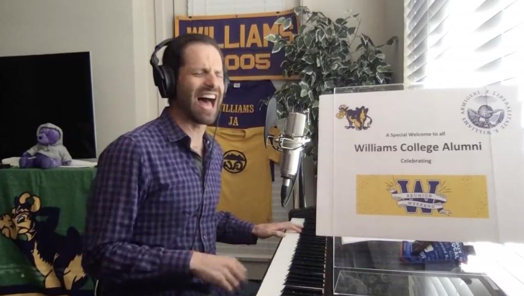 Dan Krass singing at a piano