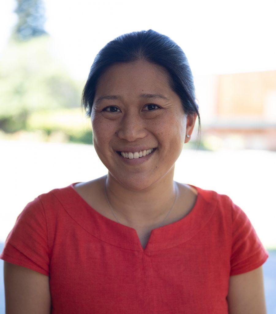 Woman smiling wearing red shirt
