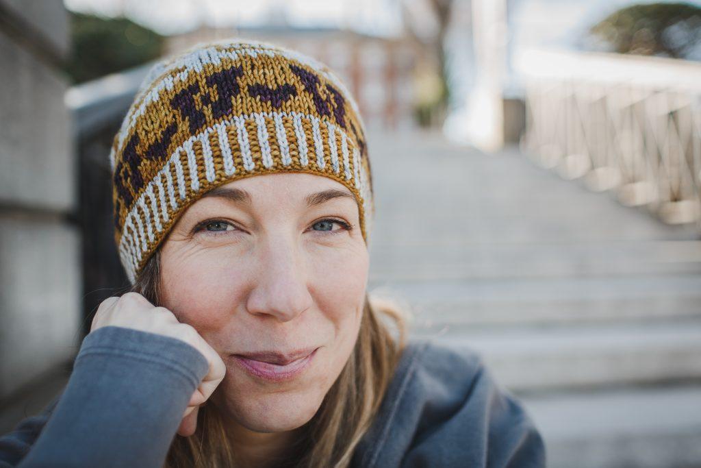 Woman wearing knit hat, smiling
