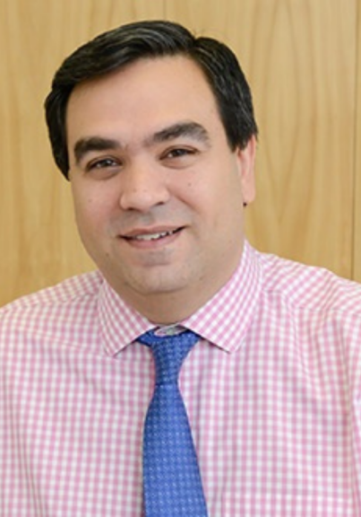 a photo of a person wearing a light pink shirt with blue tie